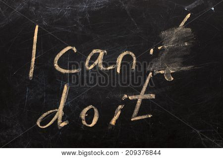 Changing The Word I Can't To I Can Do It Text On  Blackboard Background