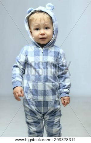 People, children, childhood concept - Cute little baby boy standing.