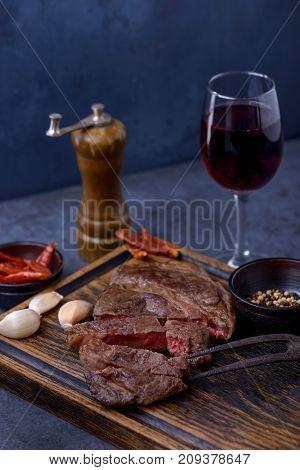 Sliced Medium Rare Grilled Steak And Red Wine