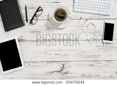 Office desk with cup of coffee tablet pc mobile phone. Business background with space for your text image picture. Flat lay