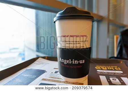 BUSAN, SOUTH KOREA - MAY 28, 2017: close up shot of paper cup at Angel-in-us Coffee. Angel-in-us Coffee is a coffeehouse chain based in South Korea and owned by the Lotte group.