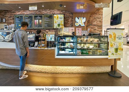 BUSAN, SOUTH KOREA - MAY 28, 2017: inside Angel-in-us Coffee at Lotte Department Store. Angel-in-us Coffee is a coffeehouse chain based in South Korea and owned by the Lotte group.