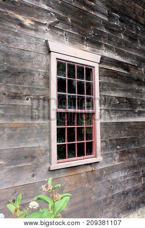 Twelve over twelve window panes of an 18th century building.