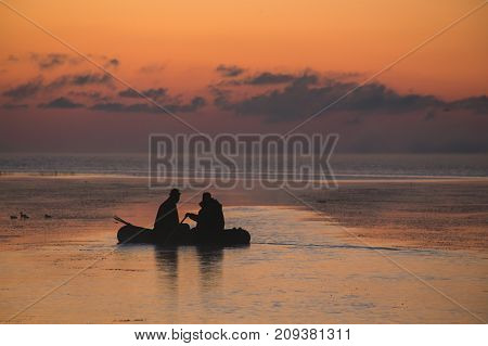 Fishermen In A Boat At Dawn, Bright Colors