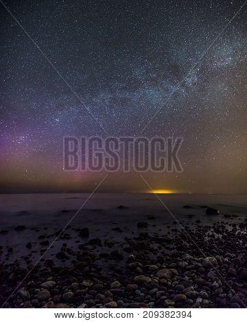 Polar aurora over the Baltic sea starry sky