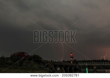 The Lightning Strikes The Water On The River At Night