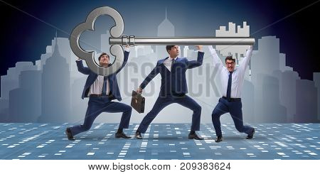 Businessmen holding giant key in business concept