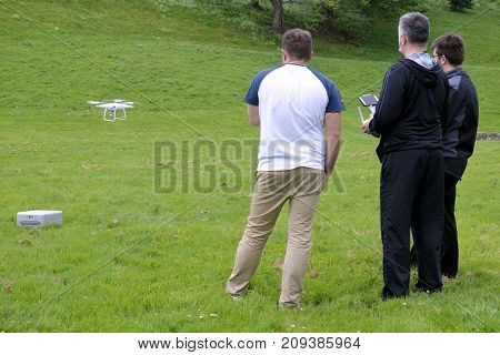 Men Flying A Drone In The Park