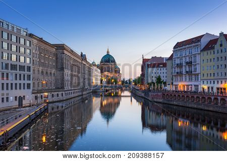 Architecture of Berlin reflected in Spree River, Germany
