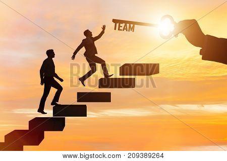 Businessmen on career ladder in teamwork concept