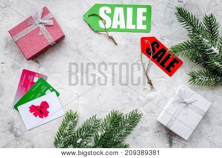 online payment for christmas present with credit card on gray stone table background top view mockup