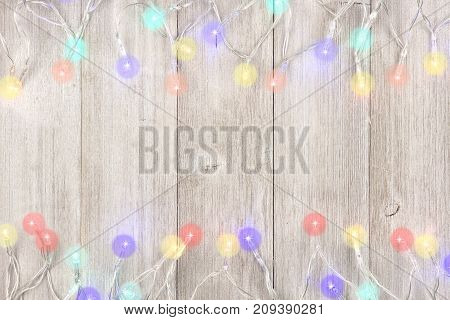 Twinkling Christmas Lights Double Border, Above View On A Light Gray Wood Background