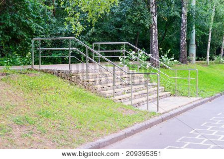 modern staircase in the summer park. background nature.