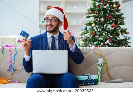 Businessman working at home during christmas