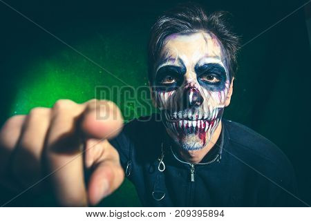 scary halloween skeleton man point with finger in camera studio shot closeup