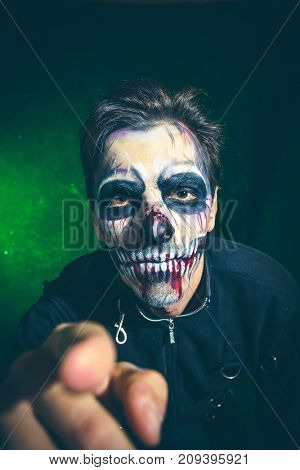 scary halloween skeleton man point with finger studio shot closeup