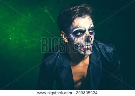 scary halloween skeleton man in jacket studio shot