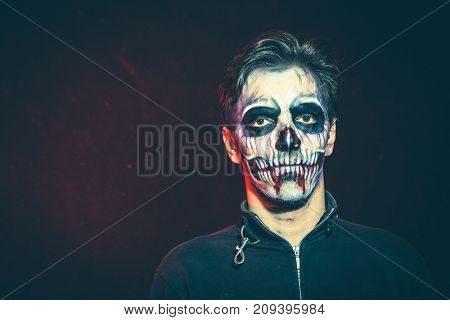 scary halloween skeleton man in jacket studio shot closeup