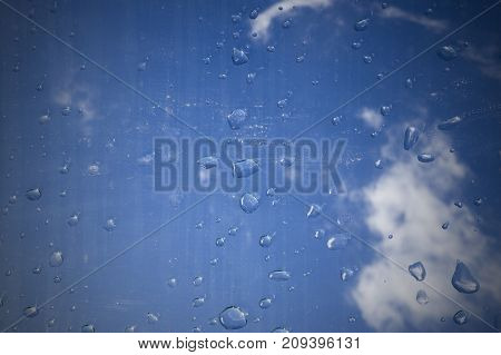 water drops on the glass under the sky. texture background.
