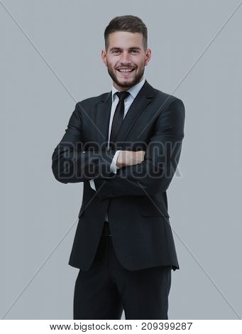 Portrait of a smiling business man. Isolated on gray