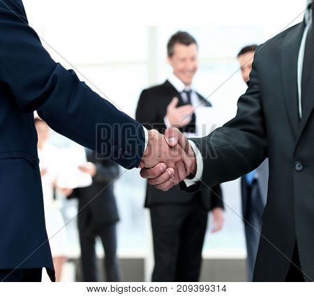 handshake between competitors before the start of business negot