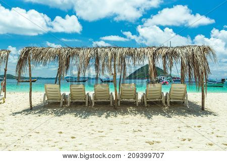 Sunbeds On A Paradise Island, A Sunny Day On The Beach Of The Resort