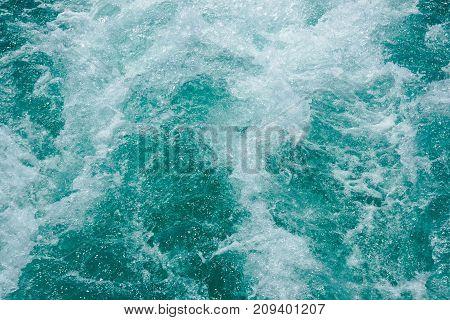The Ocean splashing waves for the background.