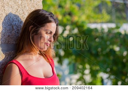 Portrait of a happy young woman, outdoor