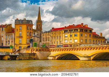 Cityscape of Metz, Lorraine, France. Beautiful image of old french town with colorful historical buildings against cloudy sky