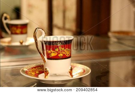 Red, white  and gold fine porcelain  tea cup