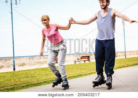 Active Young People Friends Rollerskating Outdoor.