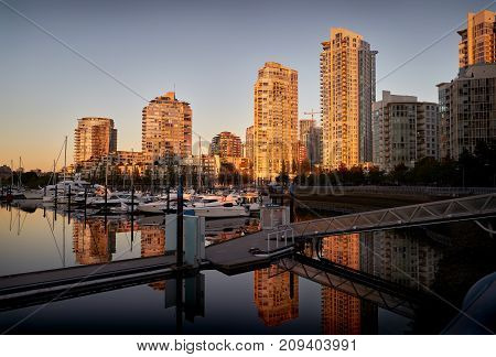 Yaletown Dawn, Vancouver. Morning sun reflects off Yaletown condominiums in downtown Vancouver. British Columbia, Canada.