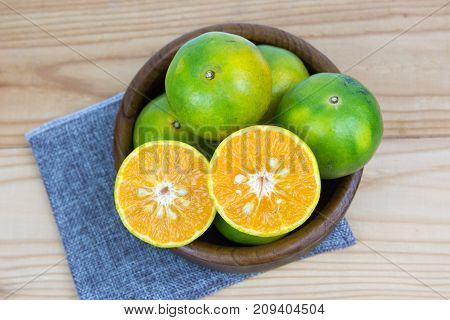 Oranges Fruit Full and Sliced on old wooden table.