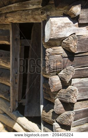 Rustic log cabin wood building structure homestead historic site texture background