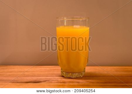 long tall glass of healthy orange juice