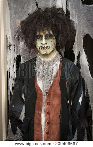 A man dressed in a zombie costume for halloween