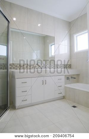 Granite bench top in bathroom with tiled walls and floors