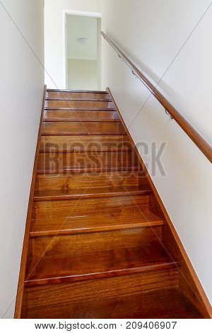 Internal timber staircase in two story house