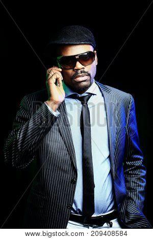 Cool black american man in dark suit.