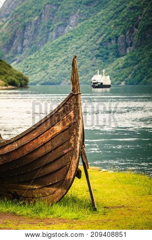 Old Viking Boat And Ferryboat In Norwegian Fjord
