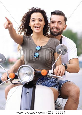 Young beautiful  couple riding on motorbike city street.