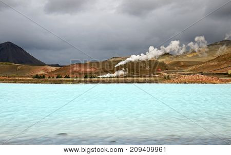 Geothermal Power Plant, area near Reykjahlid Iceland. Colourful Glacial Lake With Dramatic Stormy Sky.