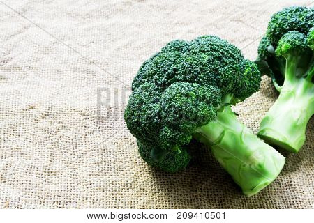 Closeup fresh broccoli on sackcloth background raw food for cooking