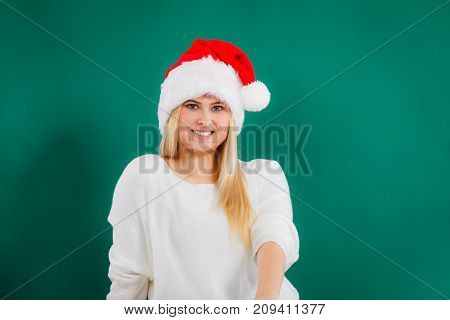Happy Woman In Santa Hat Thinking About Christmas.