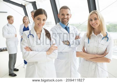 Medical doctors group in modern office with panoramic windows