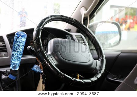 The modified gear stick and steering wheel of the car in Thailand.