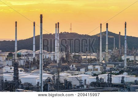 Oil Refinery factory in the sunset , petrochemical plant , Petroleum.