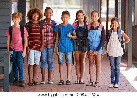 Portrait of kids standing in elementary school hallway