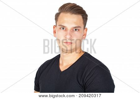 Confident young man looking at the camera on isolated background