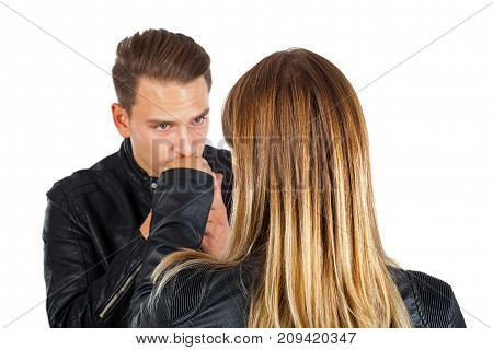 Romantic young man kissing his girlfriend's hand on isolated background